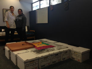 Teresa Mora and Alina Fernandez with boxes for the CLRC Archive.