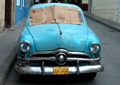 Blue car, Santiago de Cuba.  Photo by Lewis Watts.