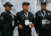 Officers posing at a security exposition, Guadalajara, Mexico.