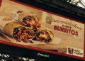 Advertisement for KFC Burritos, Glasgow Central Station, UK.