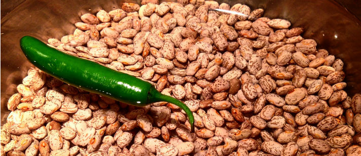 Pinto beans in water with serrano chile.  Photo by Catherine S. Ramírez.